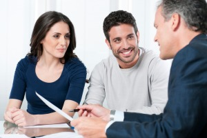 Financial consultant presents bank investments to a young couple